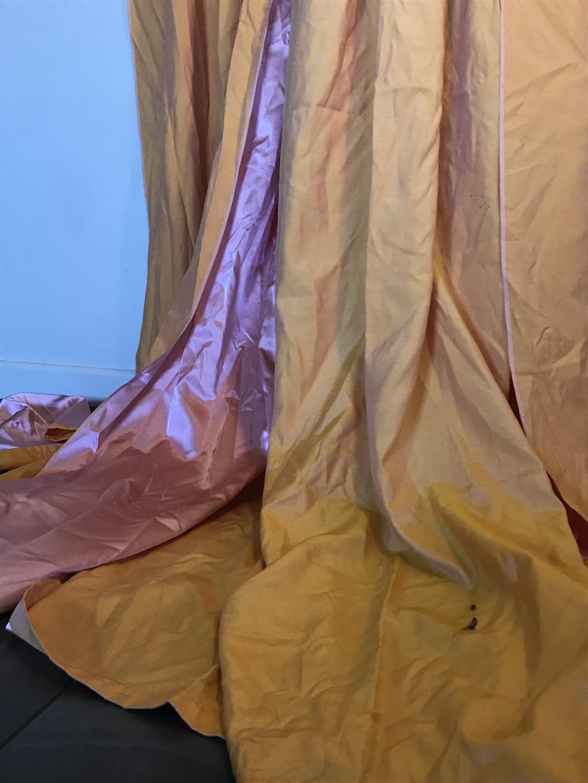 pink in orange curtains